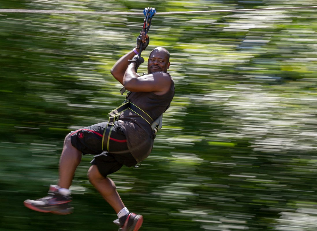 Lamond Heartwell of Durham rides a zip line at Go Ape at Blue Jay Point County Park in Raleigh.
