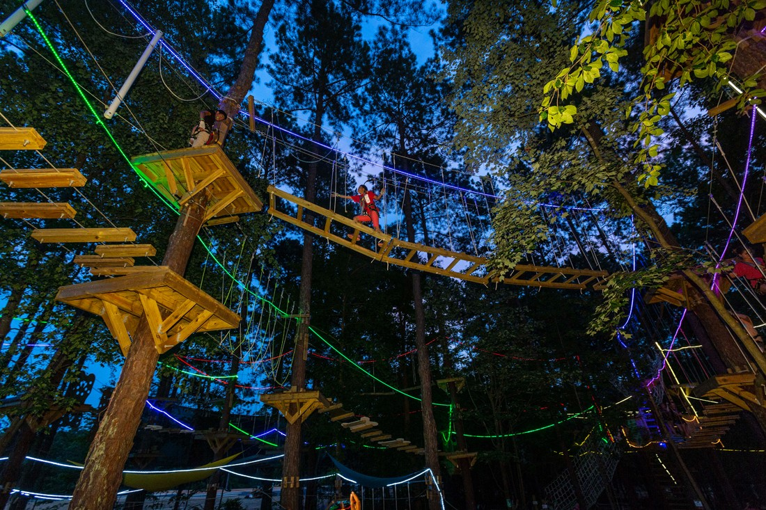 TreeRunner's Glow Nights are a popular, cooler alternative to daytime ropes courses.