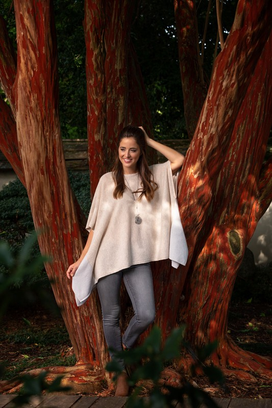 Necklace, $286<br> Gray jean, $178<br> Two-tone cashmere poncho, $288<br> From Marta's