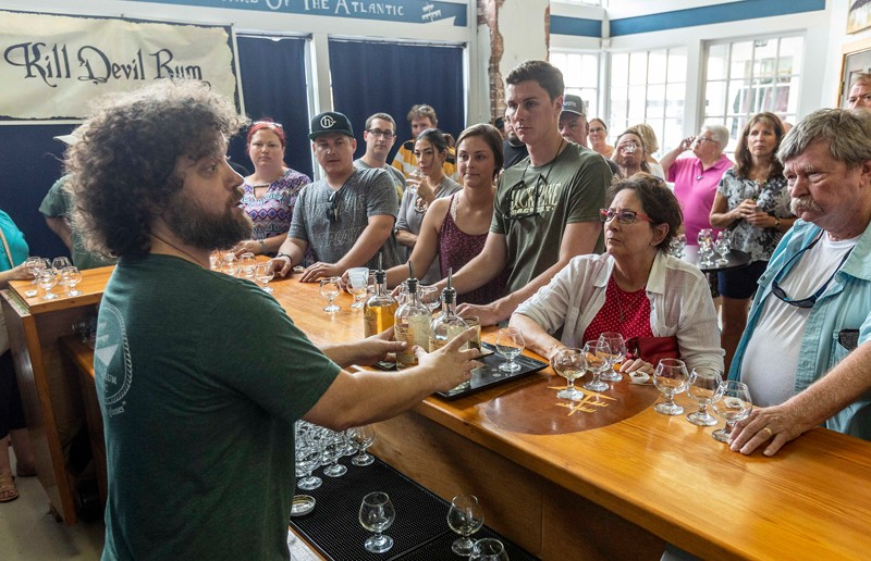Outer Banks Distilling serves up something with  more of a pirate punch, namely, its award-winning Kill Devil rums. Co-owner Matt Newsome concludes a distillery tour in the tasting room, where participants get to sample three flagship spirits, Kill Devil Silver, Pecan and Gold rums.