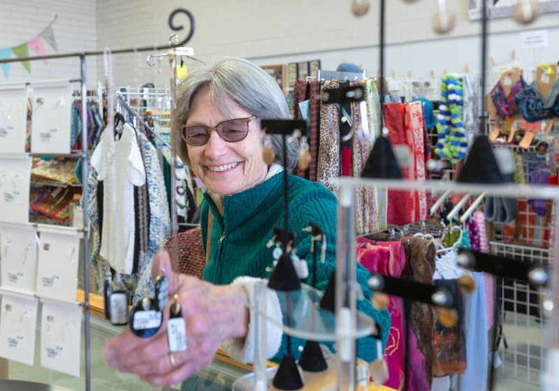 Carrboro resident Lucy Smith shops for jewelry at WomanCraft Gifts. Several local artists and craftswomen sell their creations at the shop.