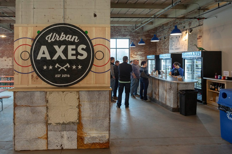 """Urban Axes is a bar where patrons can also throw axes. """"It's definitely like darts in that you're throwing something sharp at a target, but bigger,"""" says general manager Anna Clemency."""