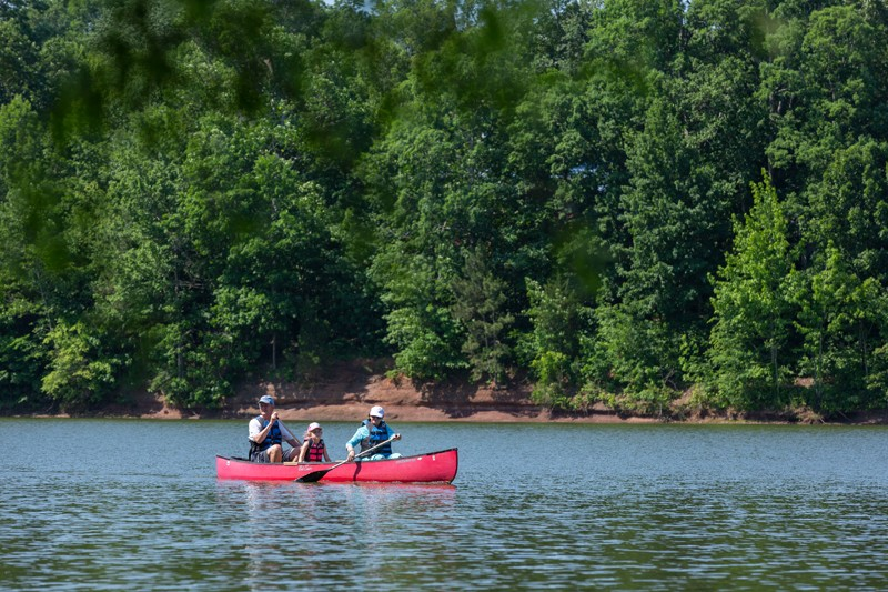 Mark Blatchford and wife, Mary Lee, paddle in a rented canoe with granddaughter Emerson York, 6. The park offers several types of boats for rent at less than $20 per hour.
