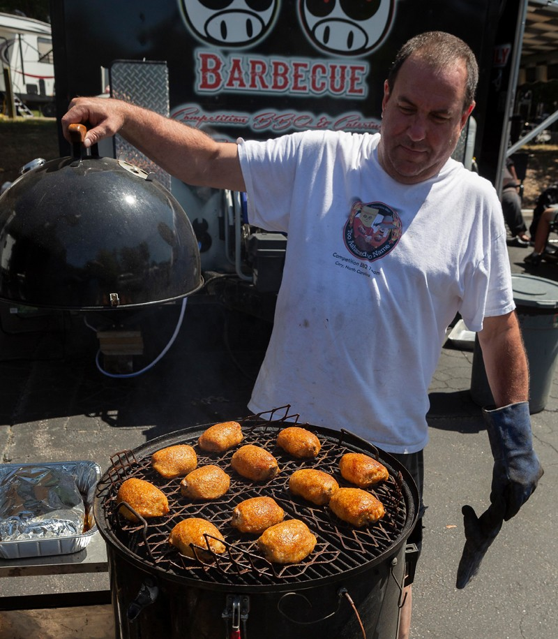Cary-resident Scott Hares of Too Ashamed to Name BBQ checks his chicken entry.