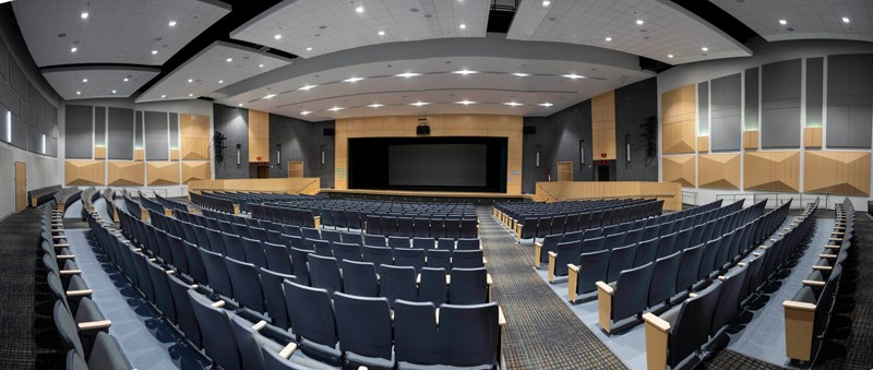 Green Level's 850-seat auditorium, top, is a modern performance space. The day-lit gymnasium, above, supports a variety of student athletes and will seat 2,200 spectators.