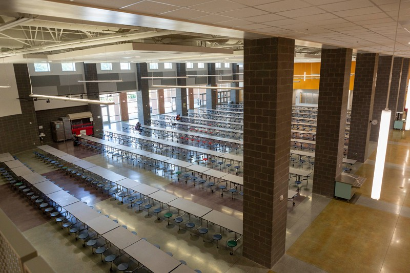 The extensive use of glass throughout the school is evident in the high-ceilinged cafeteria.