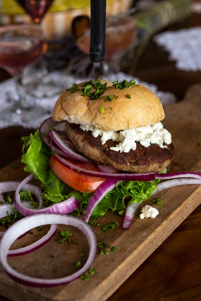 "For a different take on the lunch staple, ""My Big Fat Lamb Burger"" features fresh ground lamb, topped with feta cheese."