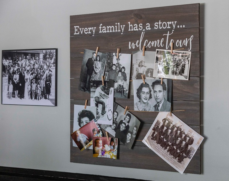 "Family photos are displayed prominently at Sophie's, where owner Desy Nikolova's motto is ""Welcome Home."""