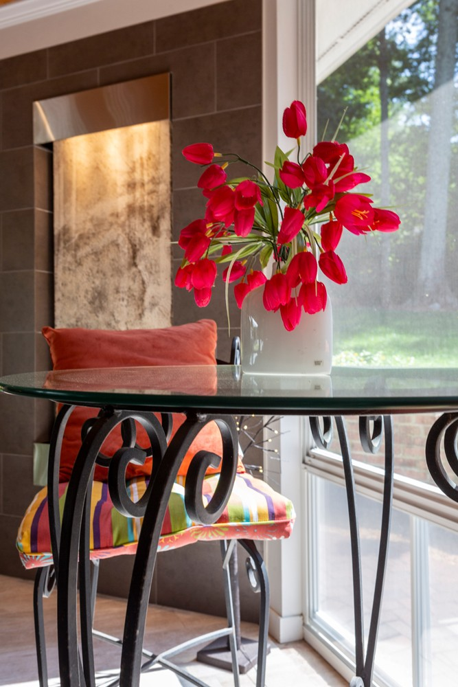 The sunroom's water feature, with its soothing burble, helps create a tranquil space where Vito and Elizabeth Guarnaccia can enjoy a cup of coffee.