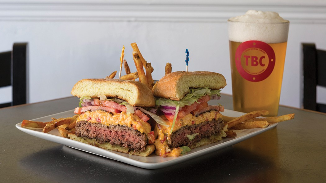 For lunch, the pimento cheeseburger and fries are served with a cold draft from the Tarboro Brewing Company.