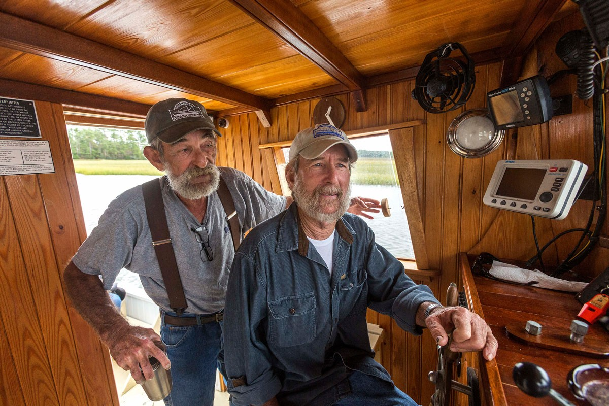 Dean Dosher, left, and his brother Don have been building boats since they were children, although neither has any formal training.