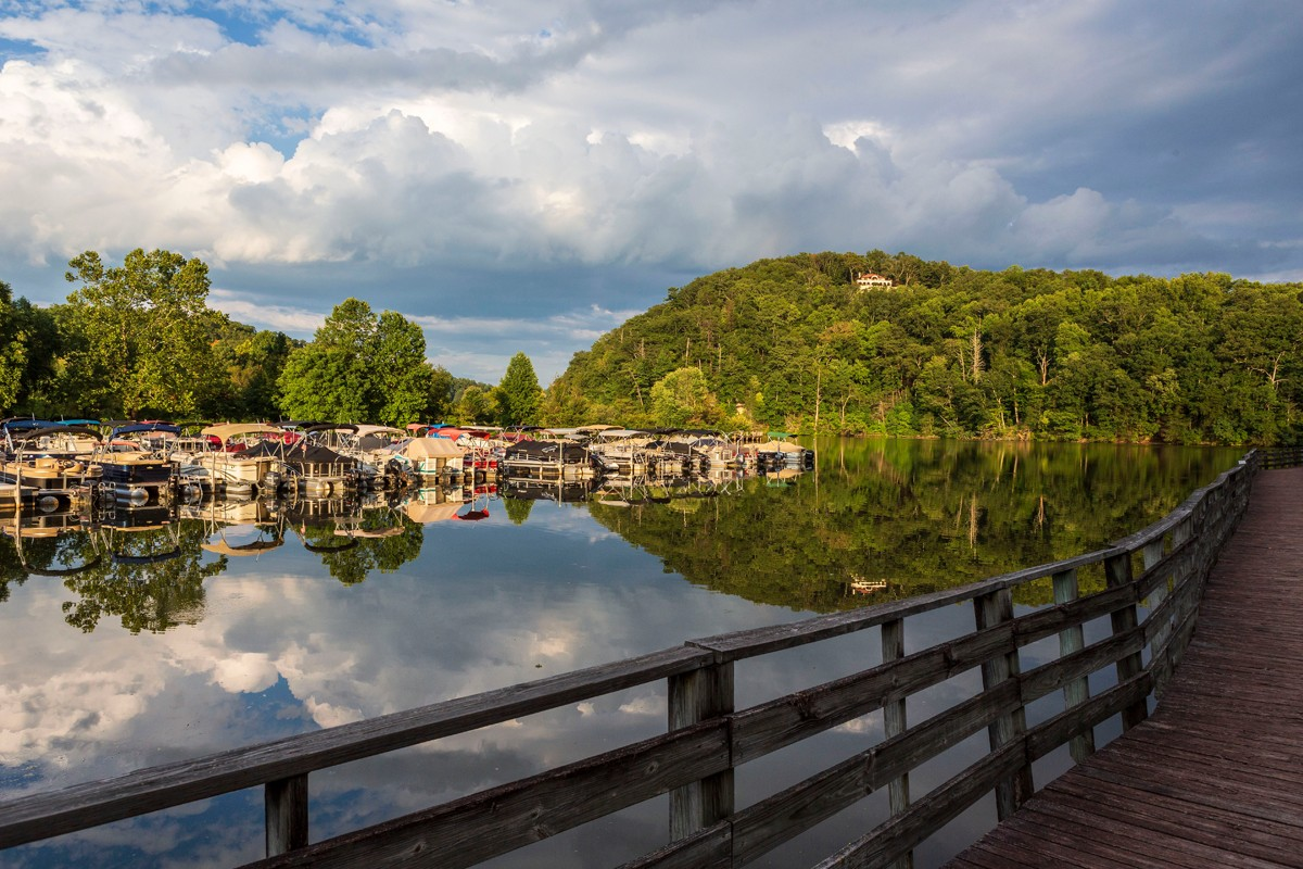A boardwalk hugs the shoreline on Lake Lure, where visitors can explore the mountain lake by rental boat, canoe and kayak, or by taking a guided boat tour.