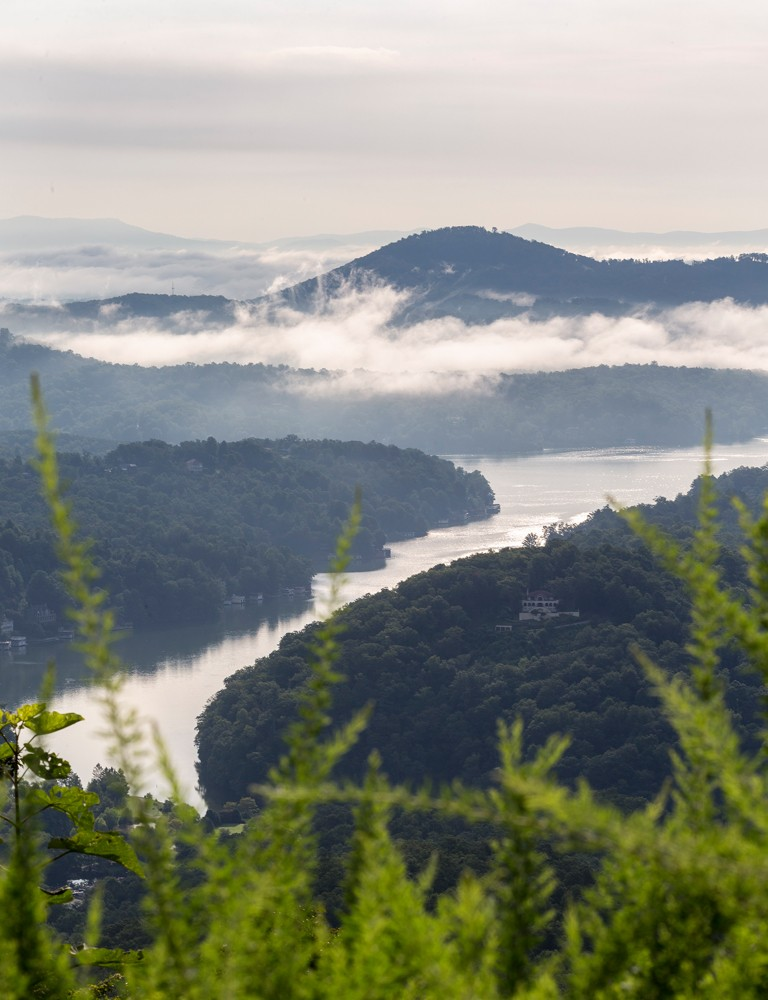 A far-reaching view of Lake Lure and the Blue Ridge Mountains awaits visitors at the top of Chimney Rock State Park.