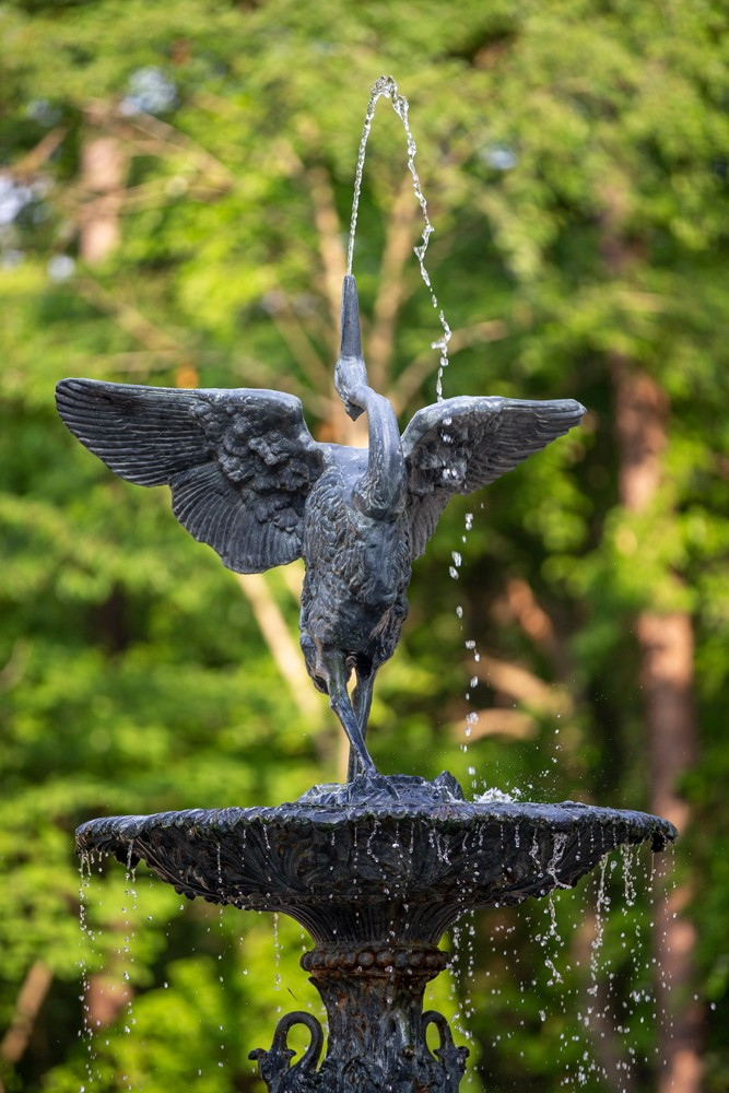 A majestic bird statue tops the Roney Fountain in the Historic Gardens.